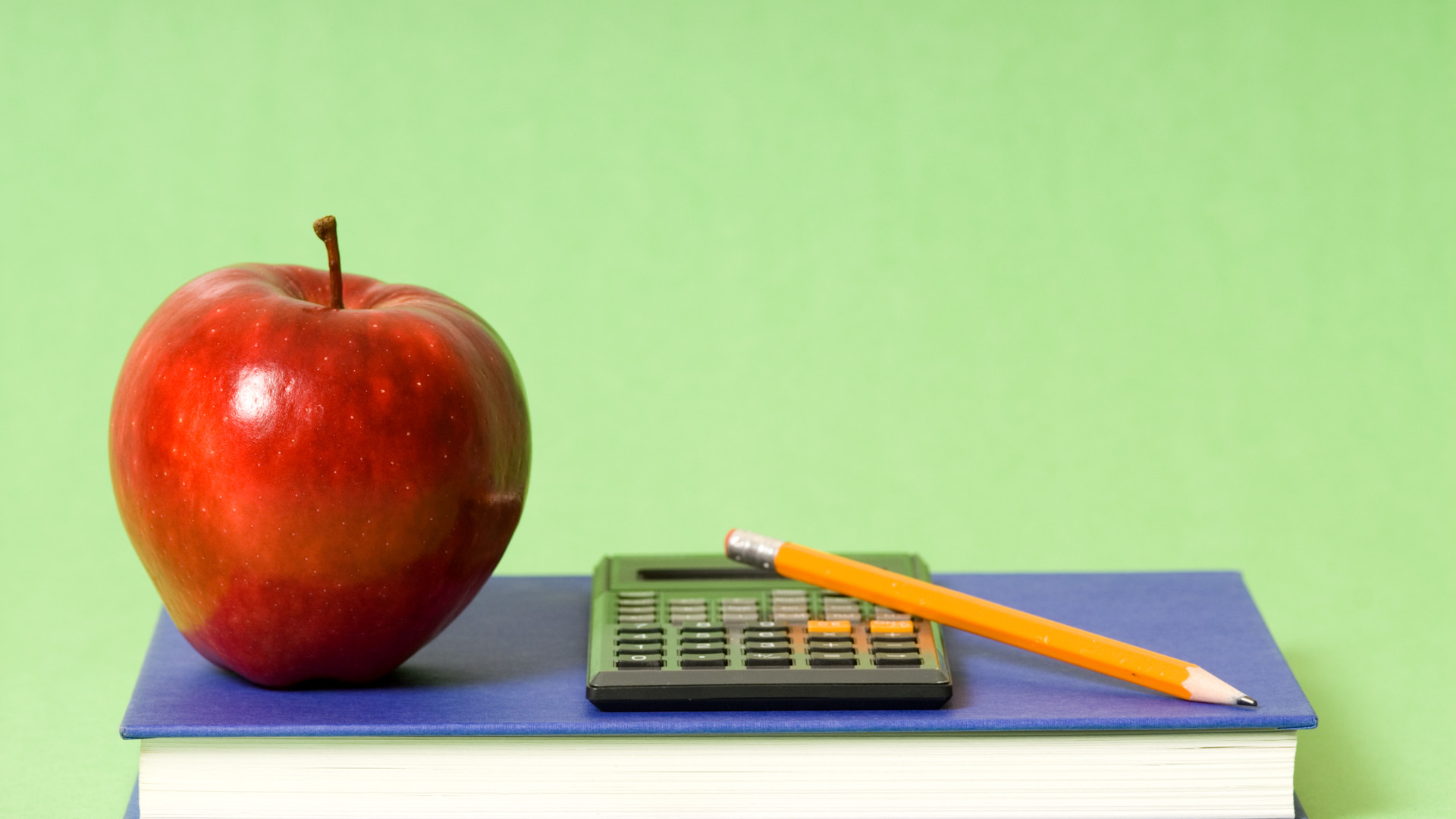 Book-apple-pencil-and-calculator-basic-school-stuff_1920x1080