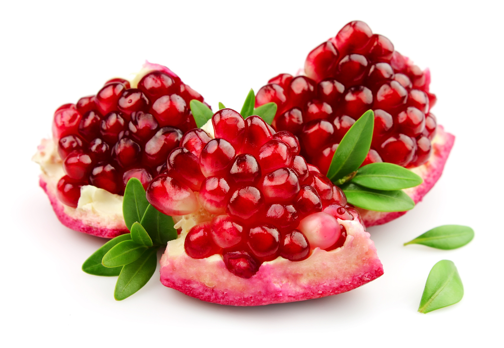 Sweet pomegranate with leafs close up