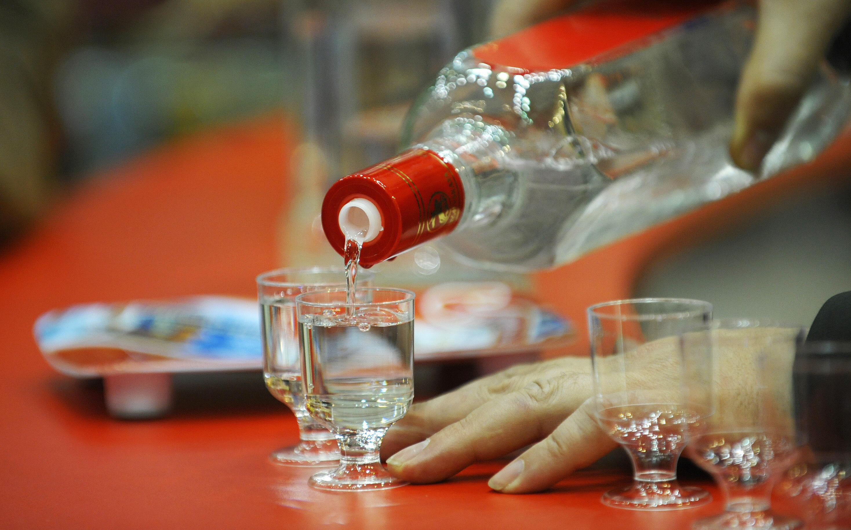 A man pours glasses of Russian Vodka as final preparations are under way for the International Green Week (Gruene Woche) Food and Agriculture Trade Fair in Berlin January 16, 2009. The Netherlands is the guest of honour at the fair which opens from 16 to 25 January 2009. AFP PHOTO DDP / MICHAEL GOTTSCHALK GERMANY OUT (Photo credit should read MICHAEL GOTTSCHALK/AFP/Getty Images)