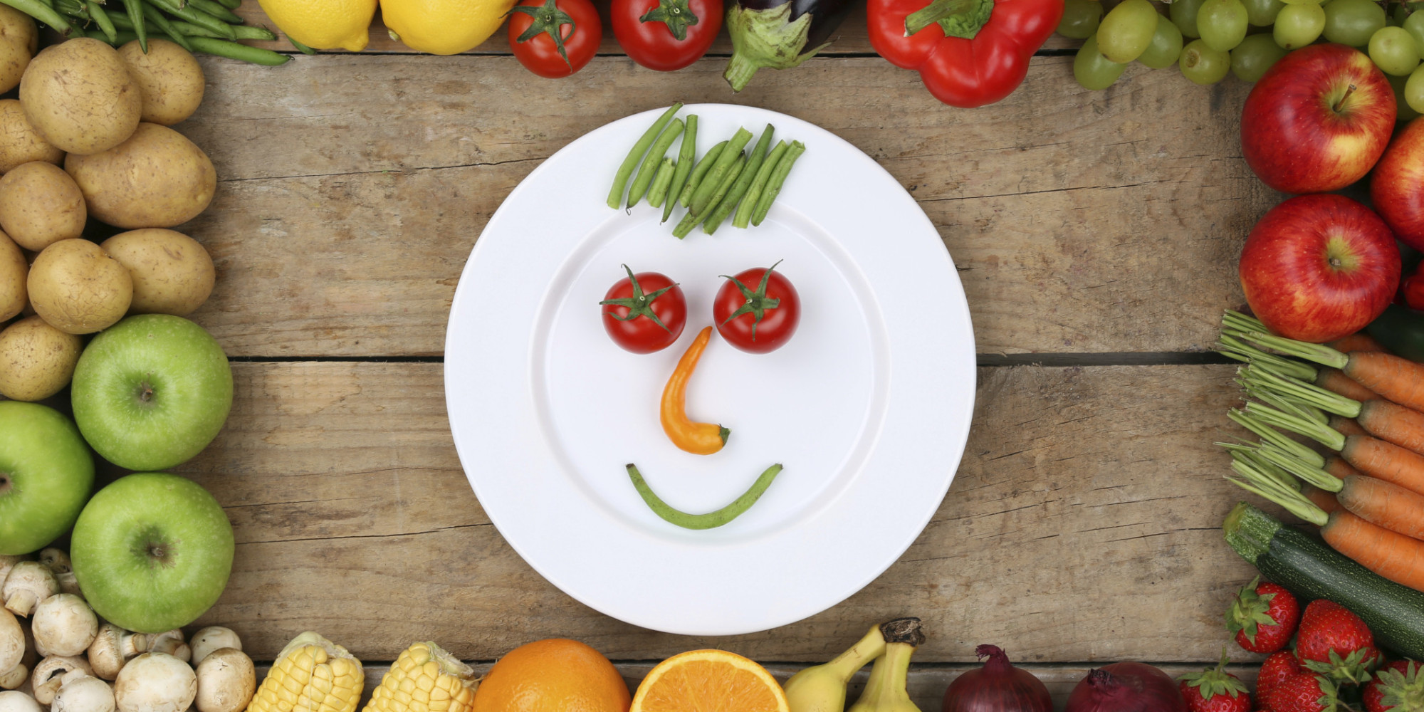 Healthy eating smiling face from vegetables on plate